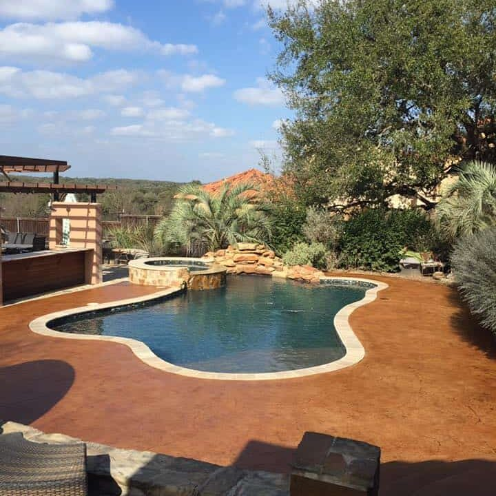 stained concrete pool surround